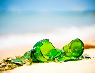Photo of broken bottle on beach