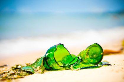 Photo of broken bottle on beach