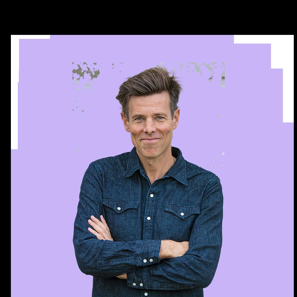 Man in denim shirt with a purple splash behind him