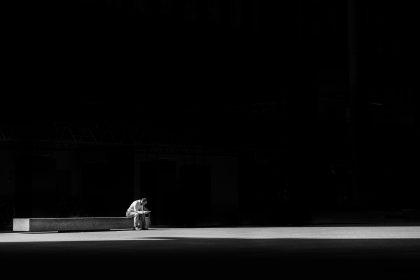 Man alone on bench